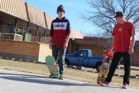 Tristen and Meason posing with skateboards