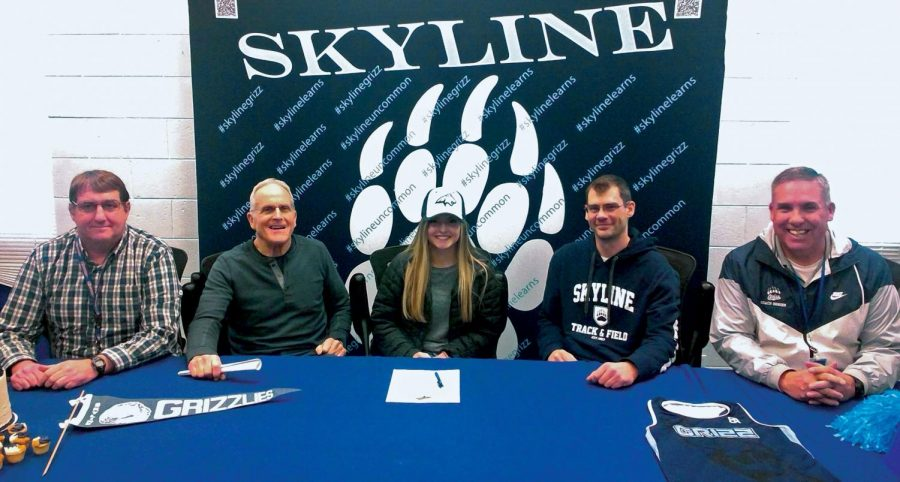 Student signing with MSU